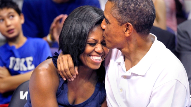 """""""Kiss Cam"""" Catches President Obama, First Lady"""