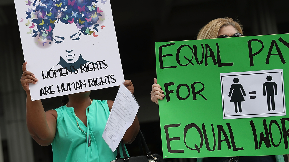 In this March 14, 2017, file photo, protesters argue for equal pay between men and women in Fort Lauderdale, Florida. Women in the state earned 87 percent as much as men in 2015 and had few statewide equal pay protections, according to an NBC News analysis released on Equal Pay Day, April 4, 2017.
