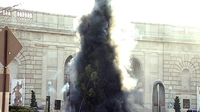 Chinese artist Cai Guo Quiang staged a pyrotechnic Christmas tree lighting outside the Smithsonian Freer Gallery of Art Friday. The smoke that cascaded around the 40-foot-tall tree afterward is meant to mimic the strokes of a traditional Chinese brush drawing.