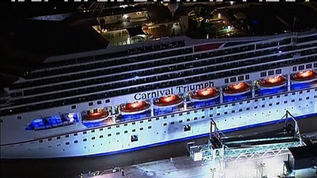 The crippled Carnival Triumph was cheered into port Thursday night after five days adrift in the Gulf of Mexico without power and with rapidly deteriorating conditions.