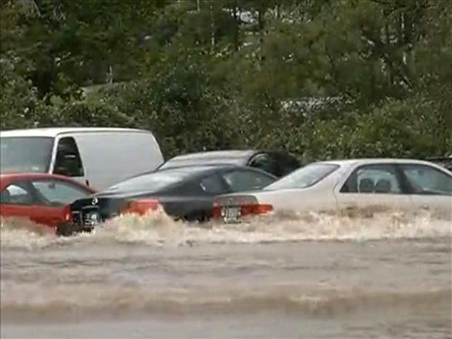A parking lot is flooded at the University of Hartford.
