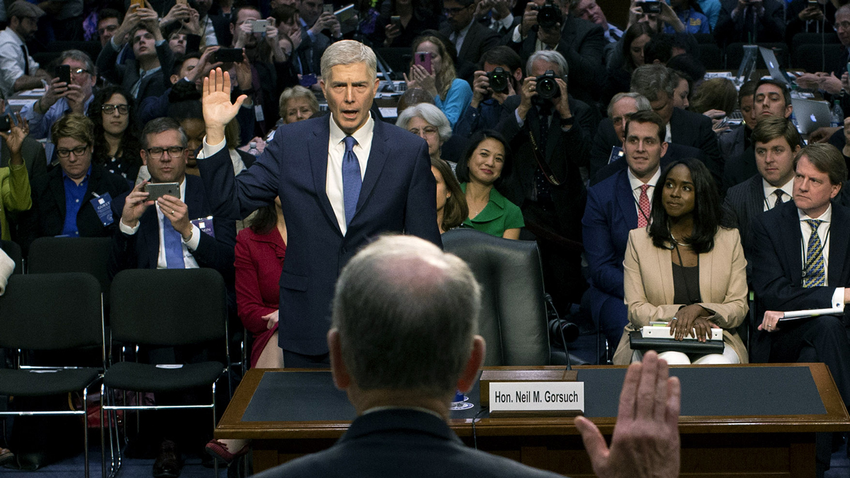 In this March 20, 2017, file photo, Senate Judiciary Committee Chairman Charles Grassley, R-Iowa (foreground), swears in Judge Neil Gorsuch during the first day of his Supreme Court confirmation hearing on Capitol Hill. Gorsuch was nominated by President Donald Trump to fill the vacancy left on the court by the February 2016 death of Associate Justice Antonin Scalia.