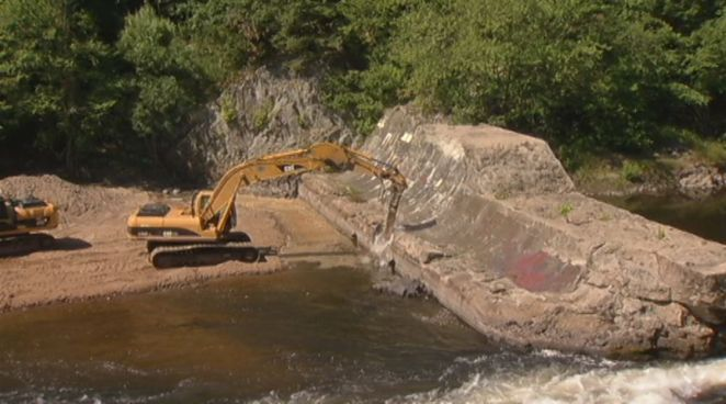 The process of removing the Spoonville dam along the Farmington River has begun. It was once used to generate power, but is now is being dismantled to help restore fish populations.