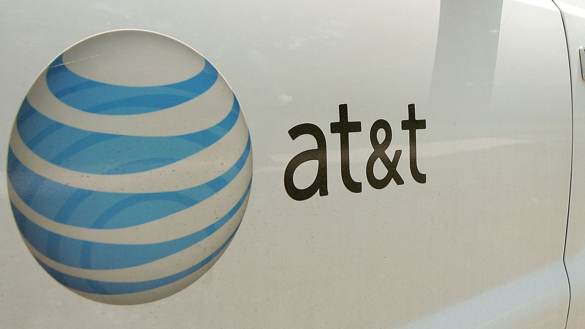 An AT&T logo is displayed on an AT&T truck. (Photo by Tim Boyle/Getty Images)