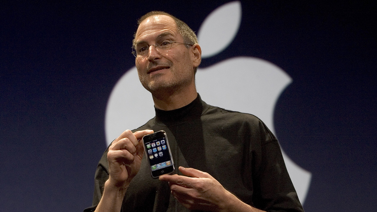 In this Jan. 9, 2007, photo, Apple CEO Steve Jobs holds up the new iPhone that was introduced at Macworld in San Francisco. The iPhone started shipping in the U.S. that June.