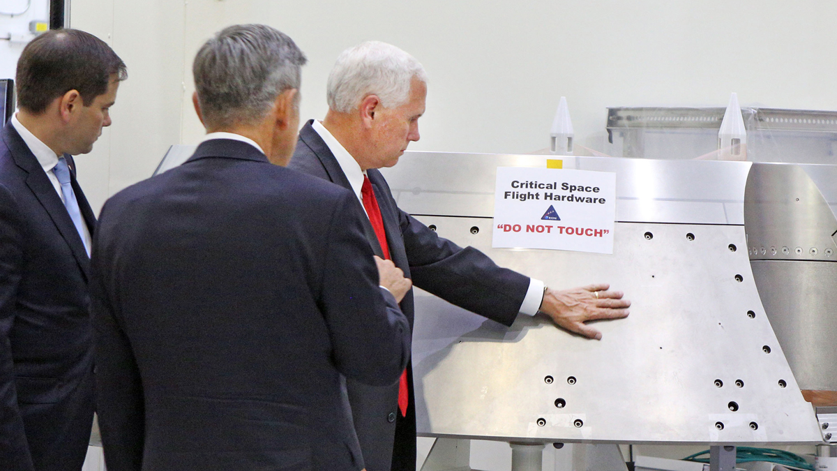 NASA Kennedy Space Center Director Bob Cabana, gives a tour of the Orion clean room to Vice President Mike Pence, right, and Sen. Marco Rubio, on Thursday, July 6, 2017. Pence is seen touching a piece of equipment labeled