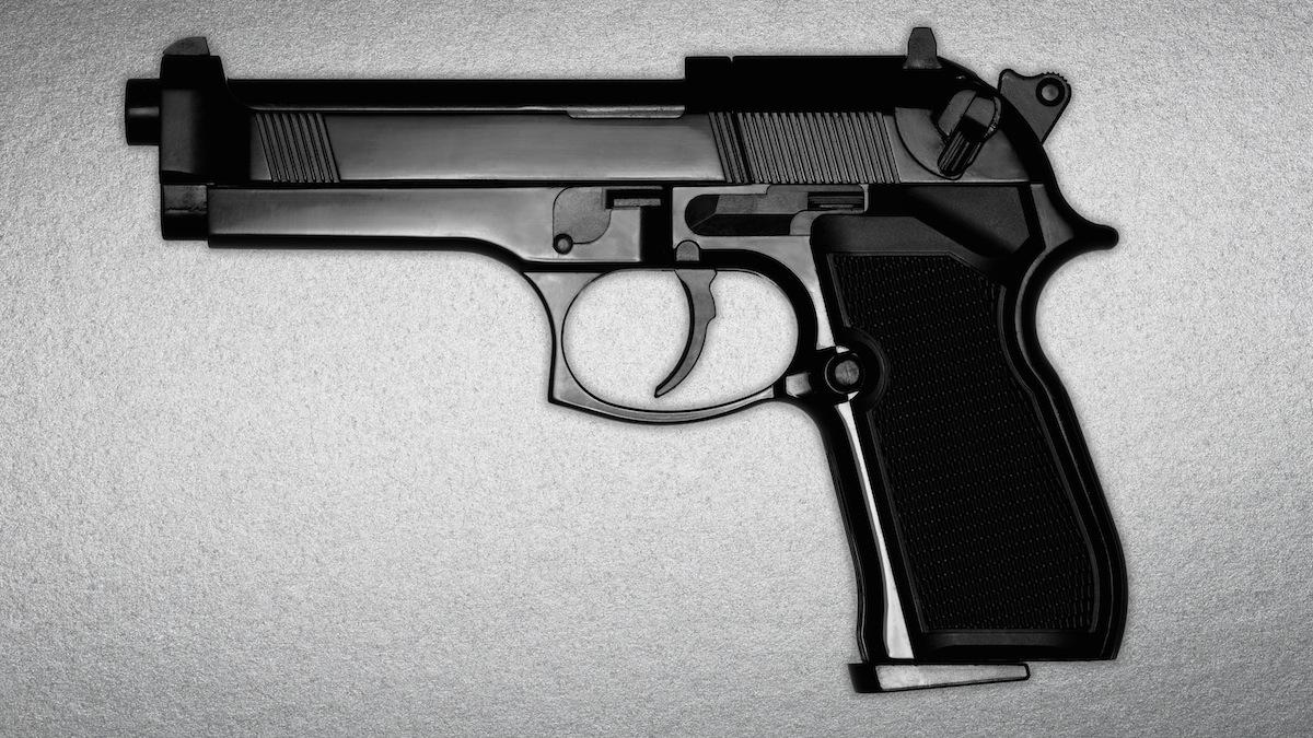FILE - A black gun
