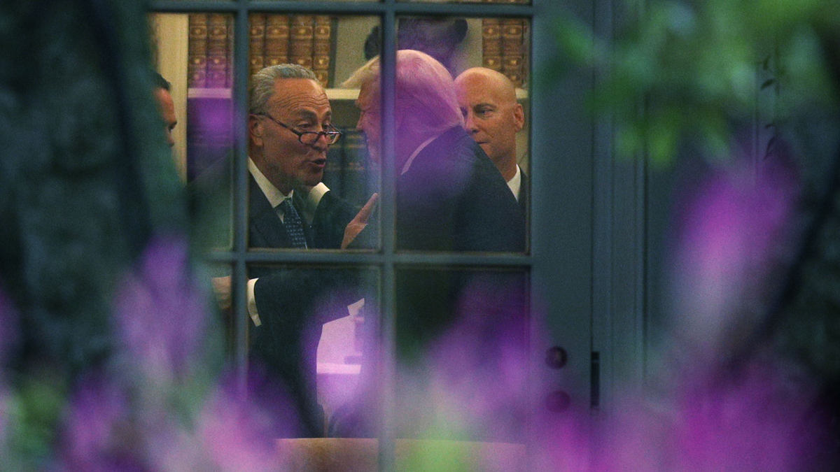 Senate Minority Leader Chuck Schumer, D-N.Y., embraces President Donald Trump in the Oval Office during a meeting on Wednesday, September 6, 2017.
