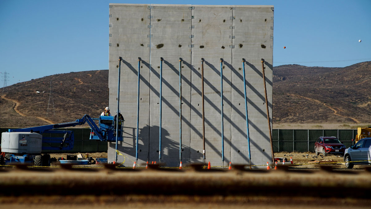 This Oct. 5, 2017, file photo shows prototype sections of a border wall between Mexico and the United States under construction near Tijuana, Mexico.