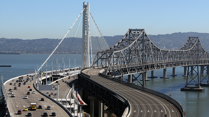 Traffic flows across the new eastern span of the San Francisco Oakland Bay Bridge on the morning after the official opening of the bridge on September 3, 2013 in San Francisco, California. (Photo by Justin Sullivan/Getty Images)