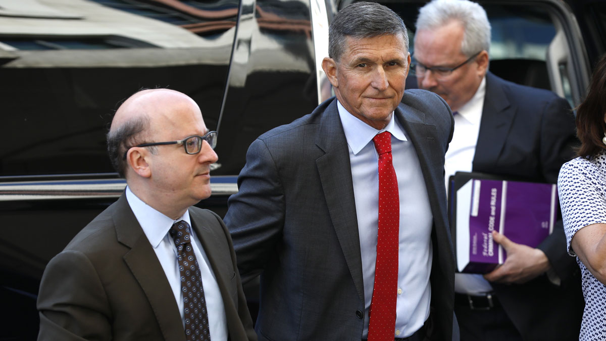 This July 10, 2018, file photo shows Michael Flynn, former U.S. national security adviser, center, arrive for a status hearing at federal court in Washington, D.C.
