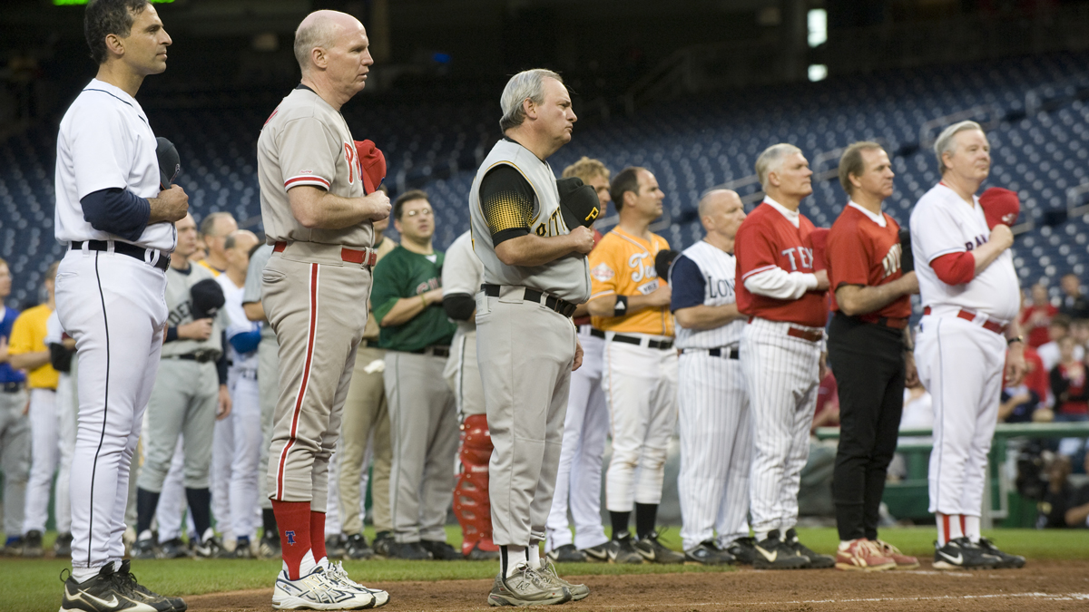 This June 17, 2009, file photo shows congressmen listen to the National Anthem before the 48th Annual Roll Call Congressional Baseball Game held at Nationals Stadium in Washington, D.C.