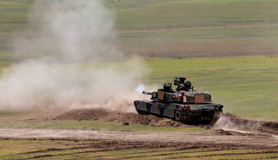 A U.S. M1A2 Abrams tank fires during joint military exercises at the Vaziani military base outside Tbilisi, Georgia, Wednesday, May 18, 2016. About 1,300 U.S., British and Georgian troops conducted joint exercises aimed at training the former Soviet republic's military for participation in the NATO Response Force.
