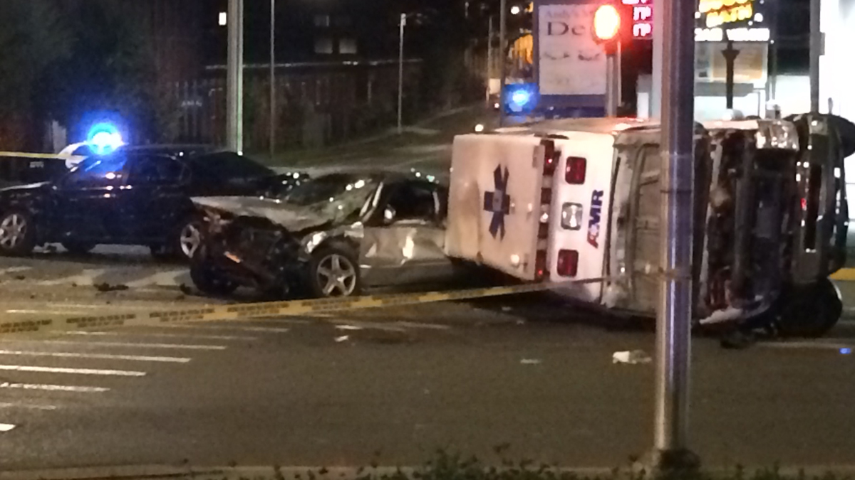 An ambulance overturned after a crash at Woodland Street and Homestead Avenue in Hartford Friday night.
