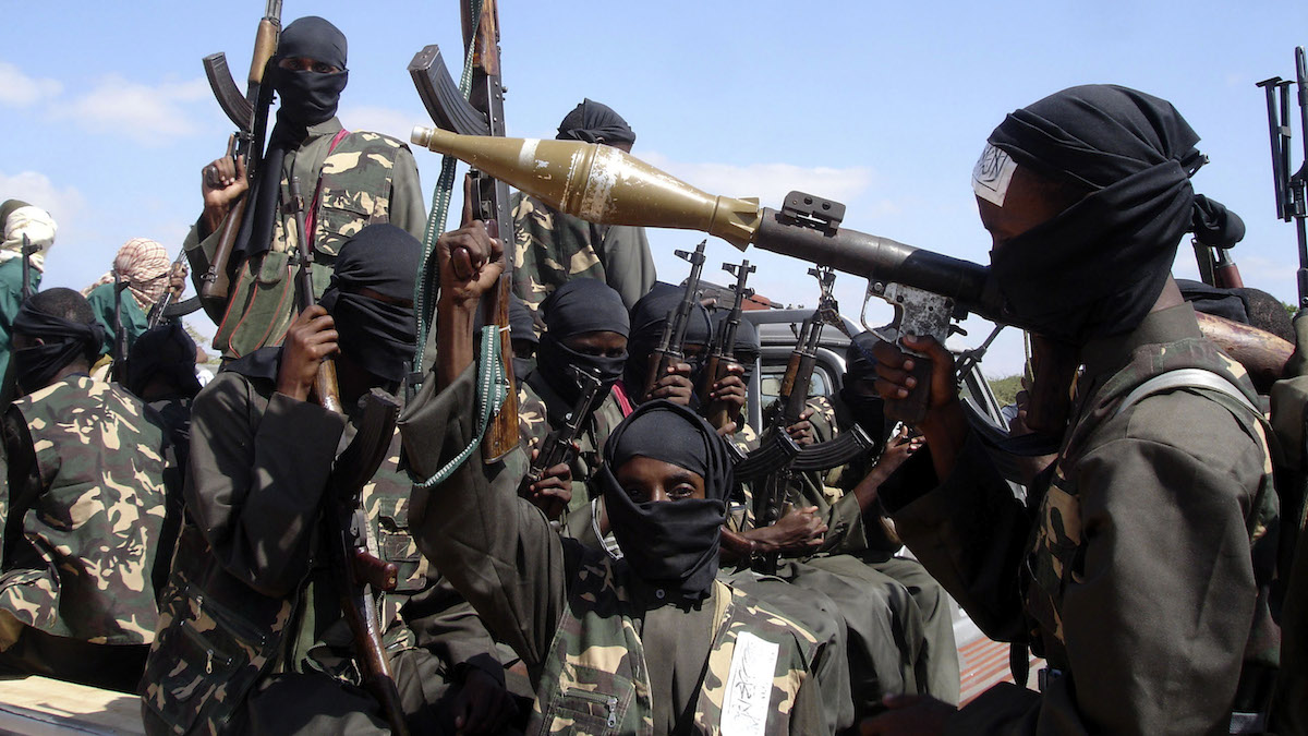 In this Dec. 8, 2008, file photo armed Al-shabab fighters just outside Mogadishu, Somalia, prepare to travel into the city in pickup trucks after vowing there would be new waves of attacks against Ethiopian troops.