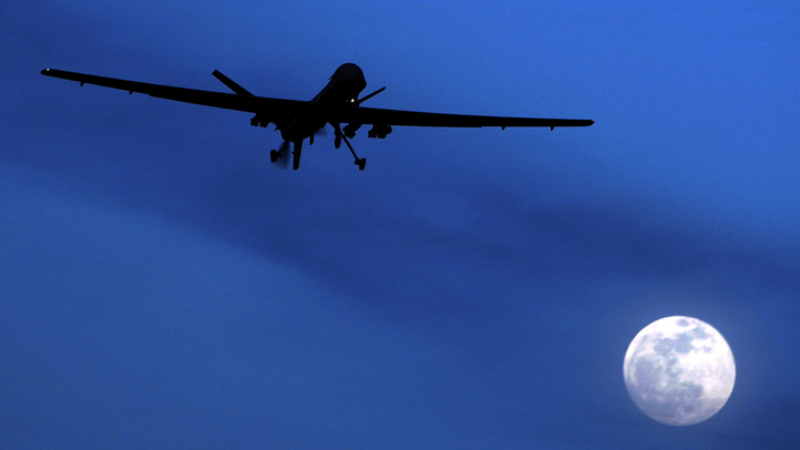 In this Jan. 31, 2010, file photo, an unmanned U.S. Predator drone flies over Kandahar Air Field, southern Afghanistan, on a moon-lit night. The Trump administration is shifting policy on drone strikes against al Qaeda and ISIS, granting the CIA and military more autonomy, NBC News reported. (AP Photo/Kirsty Wigglesworth, File)