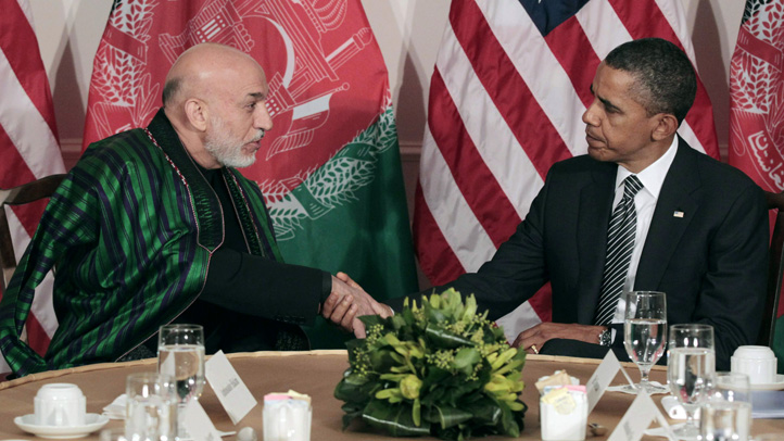 FILE - In this Sept. 20, 2011 file photo, President Barack Obama meets with Afghan President Hamid Karzai in New York.