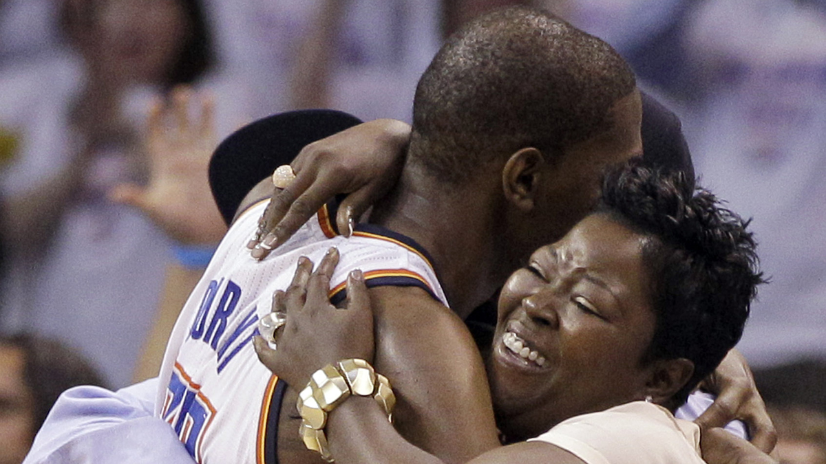 Kevin Durant hugs his mother during his final moments in a game against the San Antonio Spurs.