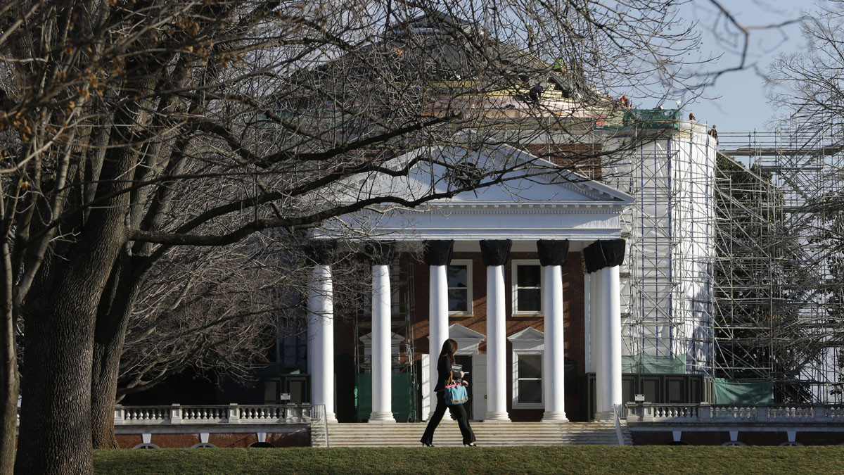 In this file photo, a student walks across the Lawn in front of the Rotunda at the University of Virginia Wednesday, Feb. 20, 2013 in Charlottesville, Va.