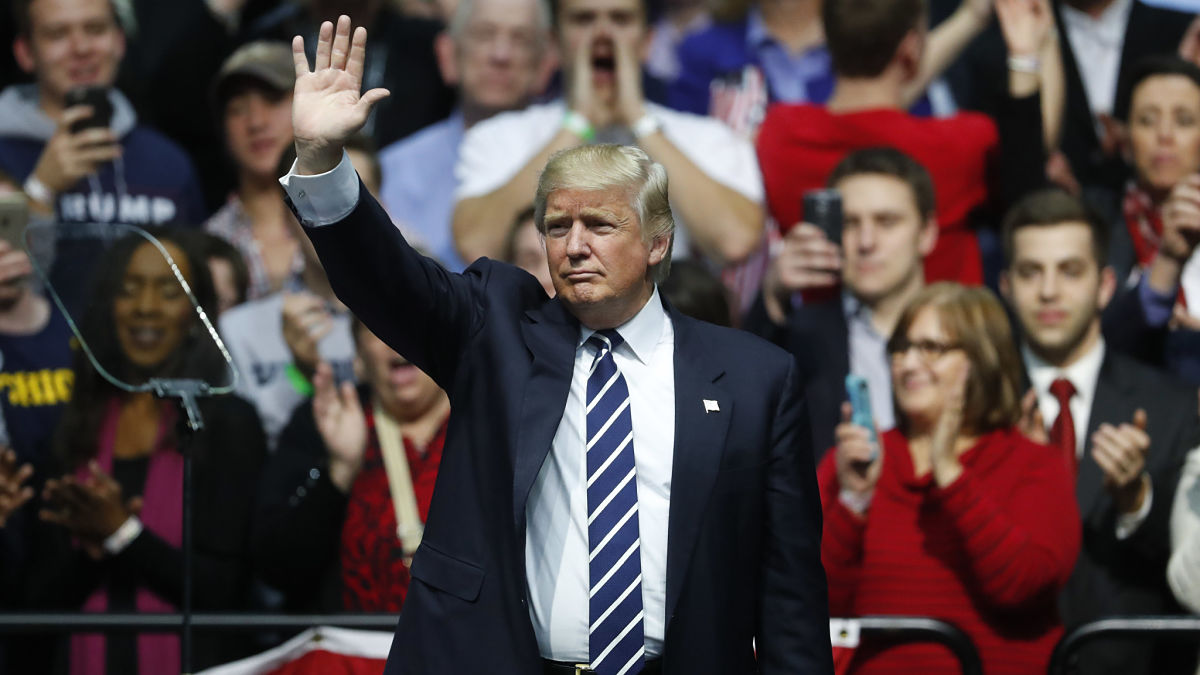 President-elect Donald Trump waves to supporters during a rally in Grand Rapids, Mich., Friday, Dec. 9, 2016.