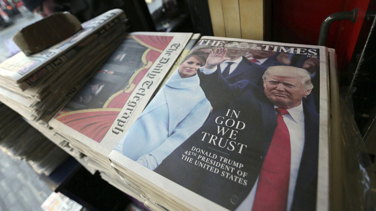 Newspapers at a newsstand in Sloane Square report on the Inauguration of President Donald Trump in London, Saturday Jan. 21, 2016.