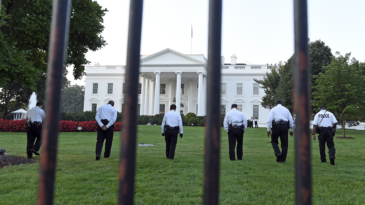 Uniformed Secret Service officers walk along the lawn on the North side of the White House in Washington, Saturday, Sept. 20, 2014. The Secret Service is coming under intense scrutiny after a man who hopped the White House fence made it all the way through the front door before being apprehended.  (AP Photo/Susan Walsh)