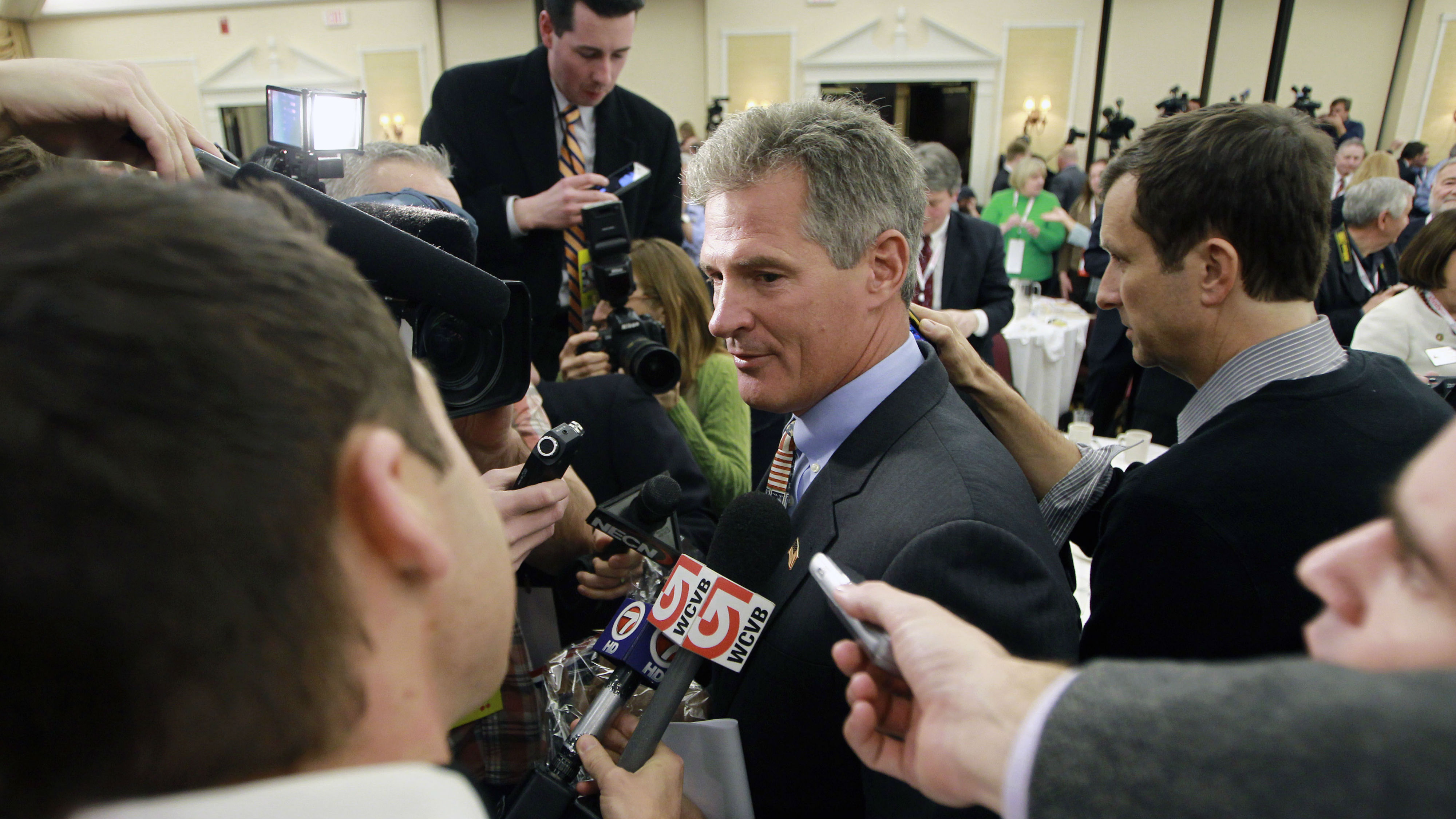 Former Sen. Scott Brown, center, leaves the ball room at the Republican Leadership Conference after announcing plans to form an exploratory committee to enter New Hampshire's U.S. Senate race against Democratic Sen. Jeanne Shaheen on Friday in Nashua, N.H.