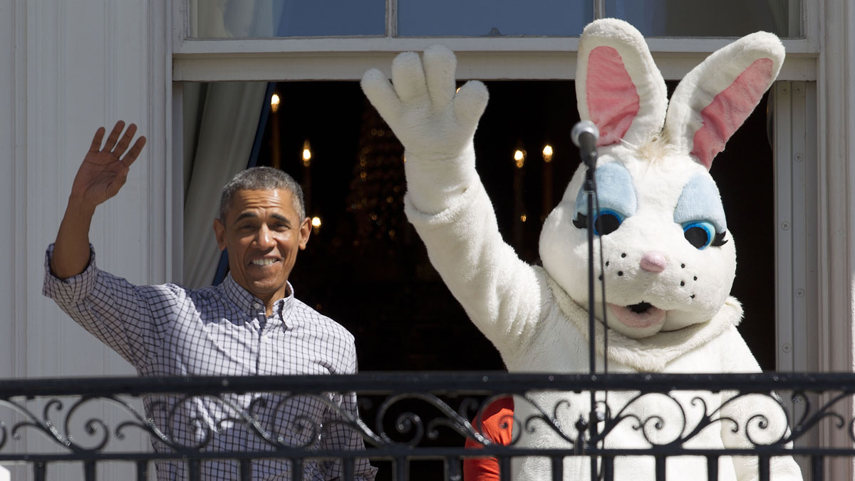 President Obama walks out and waves with the Easter Bunny on the Truman Balcony during the White House Easter Egg Roll.