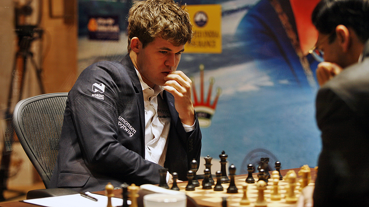 Norway's Magnus Carlsen, left, wrested the title of reigning world chess champion from India's Viswanathan Anand, right, during the Chess World Championship match in Chennai, India, Monday, Nov. 18, 2013.