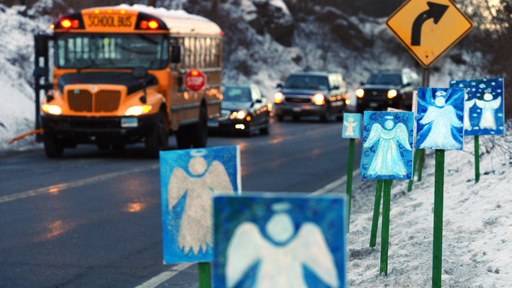 A bus traveling from Newtown, Conn., to Monroe stops in front of 26 angels along the roadside on what was the first day of classes for Sandy Hook Elementary School students since the Dec. 14, 2012 shooting. On Monday, the report on the investigation will be released.