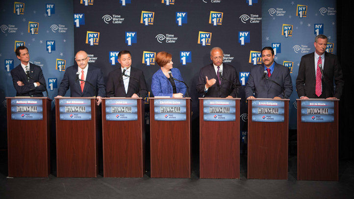 The Democratic candidates for Mayor of New York City, from left, Anthony Weiner, Sal Albanese, John Liu, Christine Quinn, William Thompson Jr., Erick Salgado and Bill de Blasio, face off for their first debate at the Town Hall Wednesday, Aug. 21.