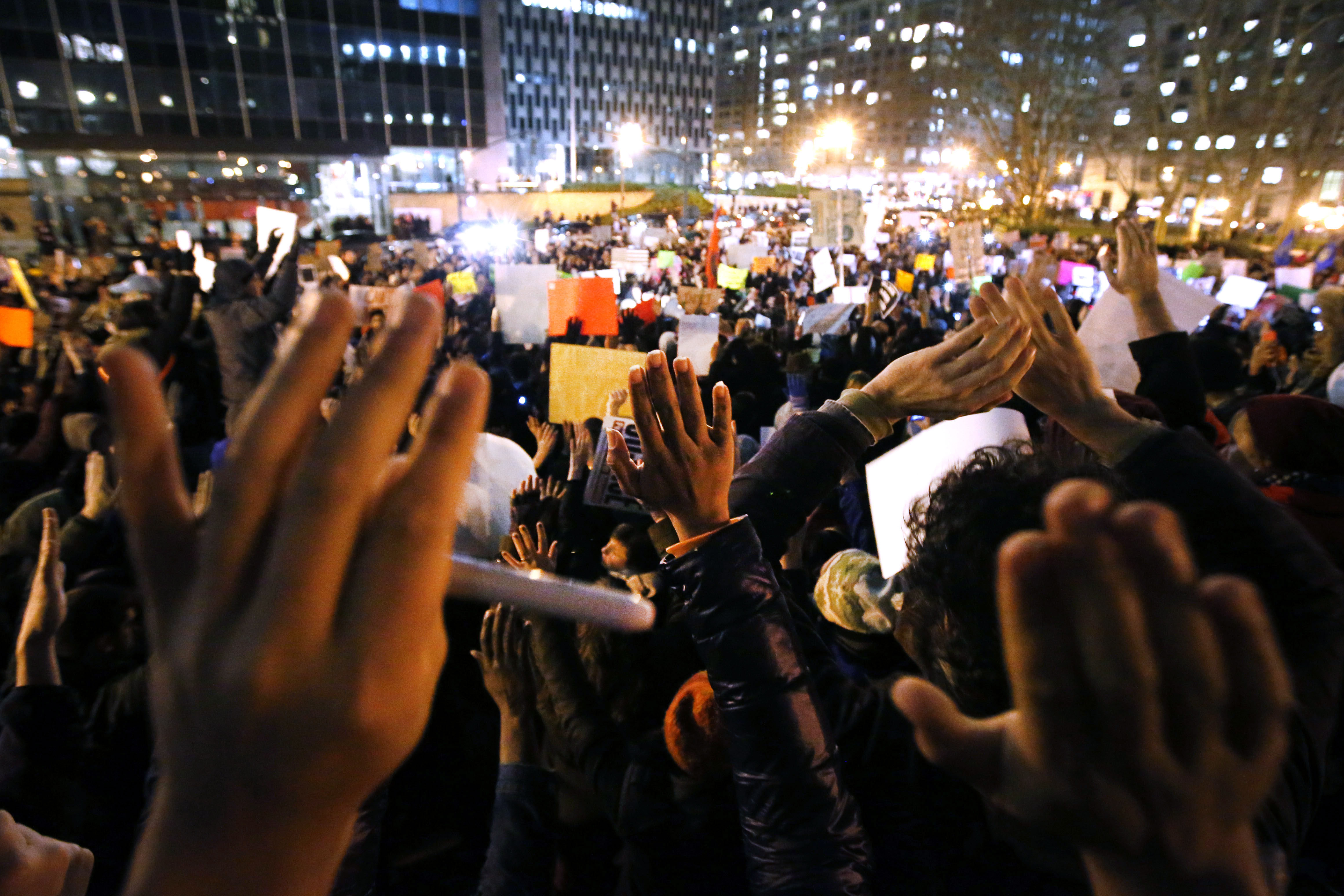 Protesters rally against a grand jury's decision not to indict the police officer involved in the death of Eric Garner in Foley Square, Thursday, Dec. 4, 2014, in New York. A grand jury cleared a white New York City police officer Wednesday in the videotaped chokehold death of Garner, an unarmed black man, who had been stopped on suspicion of selling loose, untaxed cigarettes.  (AP Photo/Jason DeCrow)