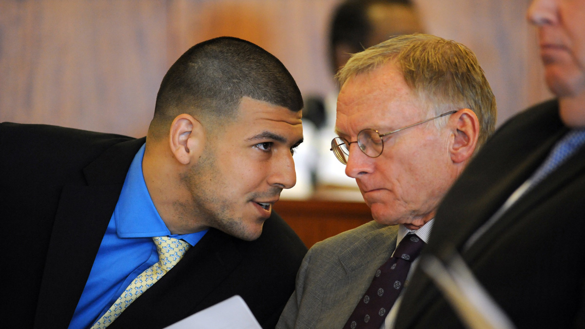Former New England Patriots NFL football player Aaron Hernandez, left, talks with one of his defense attorneys, Charles Rankin, during a hearing at the Bristol County Superior Court House, Monday, June 16, 2014, in Fall River, Mass. Hernandez's attorneys challenged the evidence in one of his murder cases, arguing at a pretrial hearing that prosecutors have not established probable cause in the fatal shooting of Odin Lloyd.