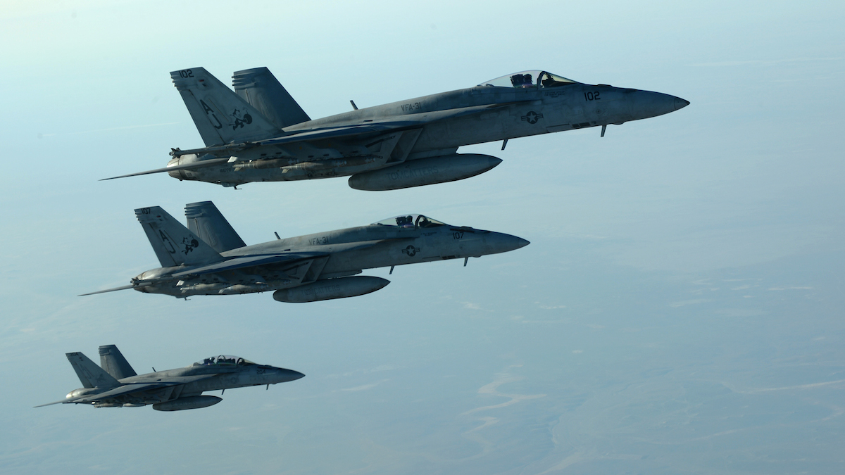 In this file photo released by the U.S. Air Force, a formation of U.S. Navy F-18 Super Hornets leaves after receiving fuel over northern Iraq, as part of U.S.-led coalition airstrikes on ISIS in Iraq and Syria.