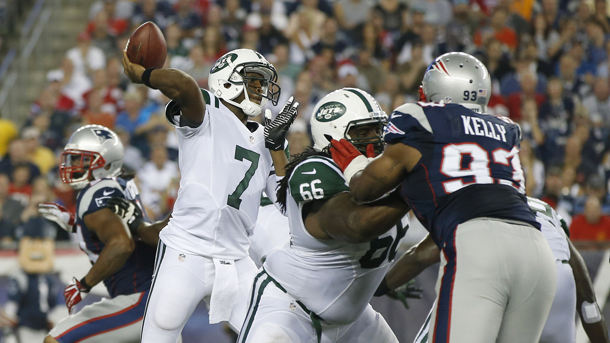 New York Jets quarterback Geno Smith (7) passes as New England Patriots defensive tackle Tommy Kelly (93) tries to fight through the block of Jets guard Willie Colon (66) first quarter an NFL football game Thursday, Sept. 12, 2013, in Foxborough, Mass. (AP Photo/Elise Amendola)