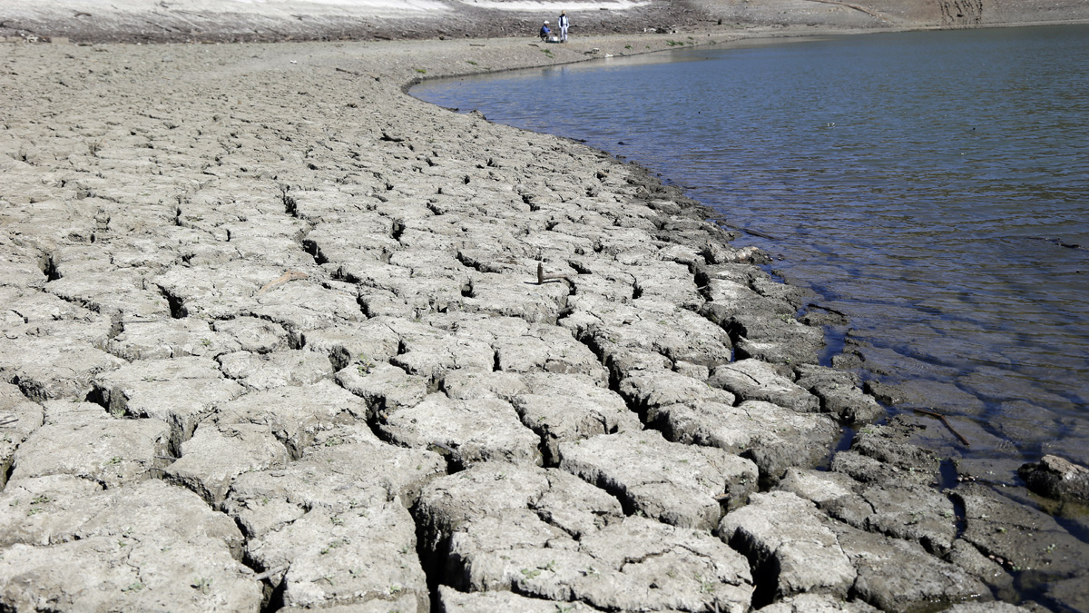 The dry-cracked bed of the Stevens Creek Reservoir is seen on March 13, 2014, in Cupertino, Calif. Lack of seasonal rain has meant water shortages for Californians.