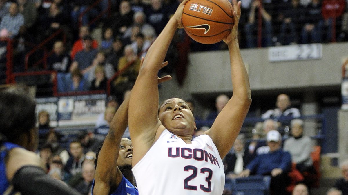 Connecticut's Kaleena Mosqueda-Lewis (23) drives past Memphis' Ariel Hearn (4) during the first half of an NCAA college basketball game in Storrs, Conn., on Saturday, Feb. 28, 2015. (AP Photo/Fred Beckham)
