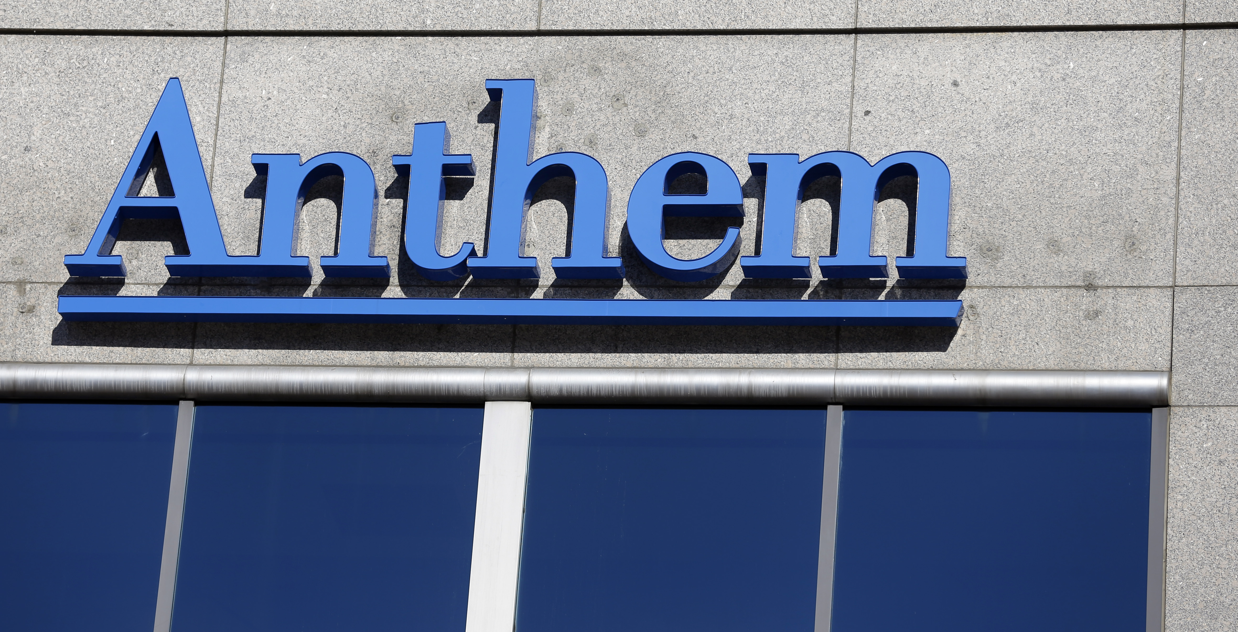 The Anthem logo hangs at the health insurer's corporate headquarters in Indianapolis, Thursday, Feb. 5, 2015. Hackers broke into the company's database storing information for about 80 million people in an attack bound to stoke fears many Americans have about the privacy of their most sensitive information.