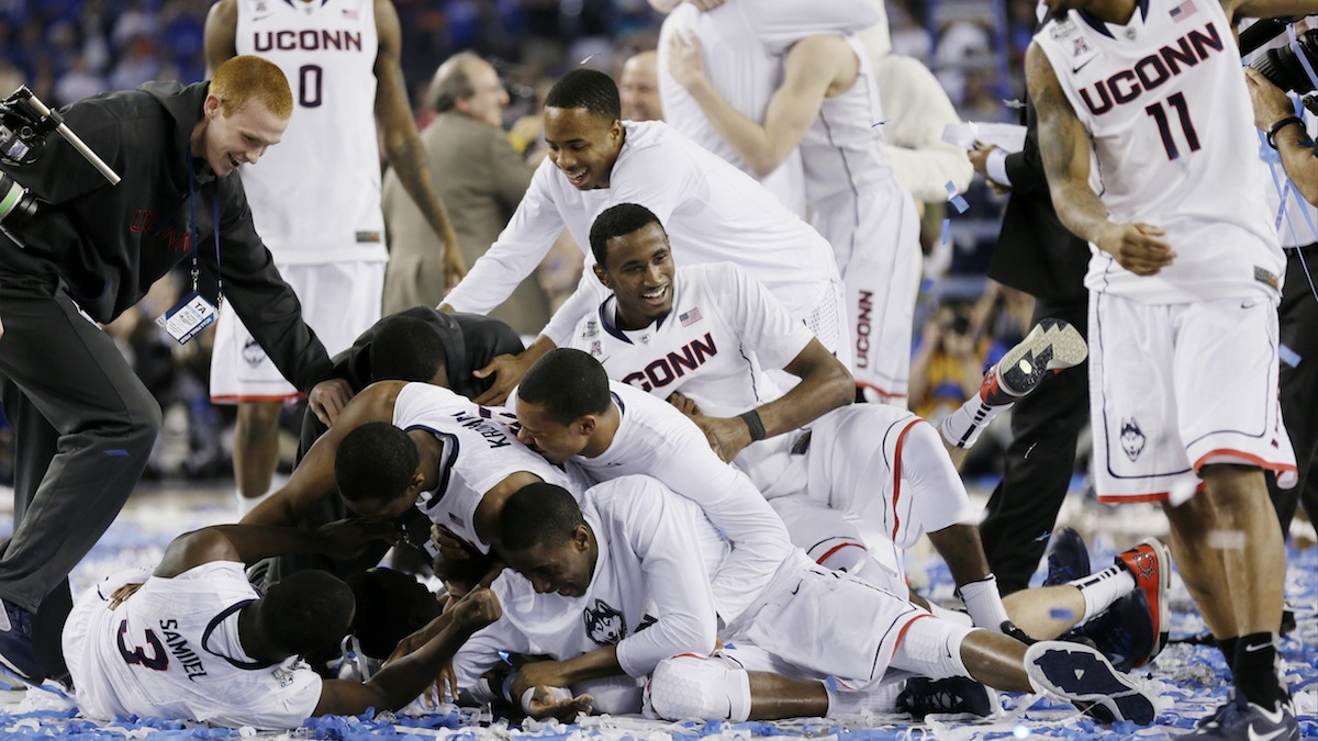 Connecticut celebrates after winning the NCAA Final Four tournament college basketball championship game against Kentucky Monday, April 7, 2014, in Arlington, Texas. (AP Photo/Charlie Neibergall)