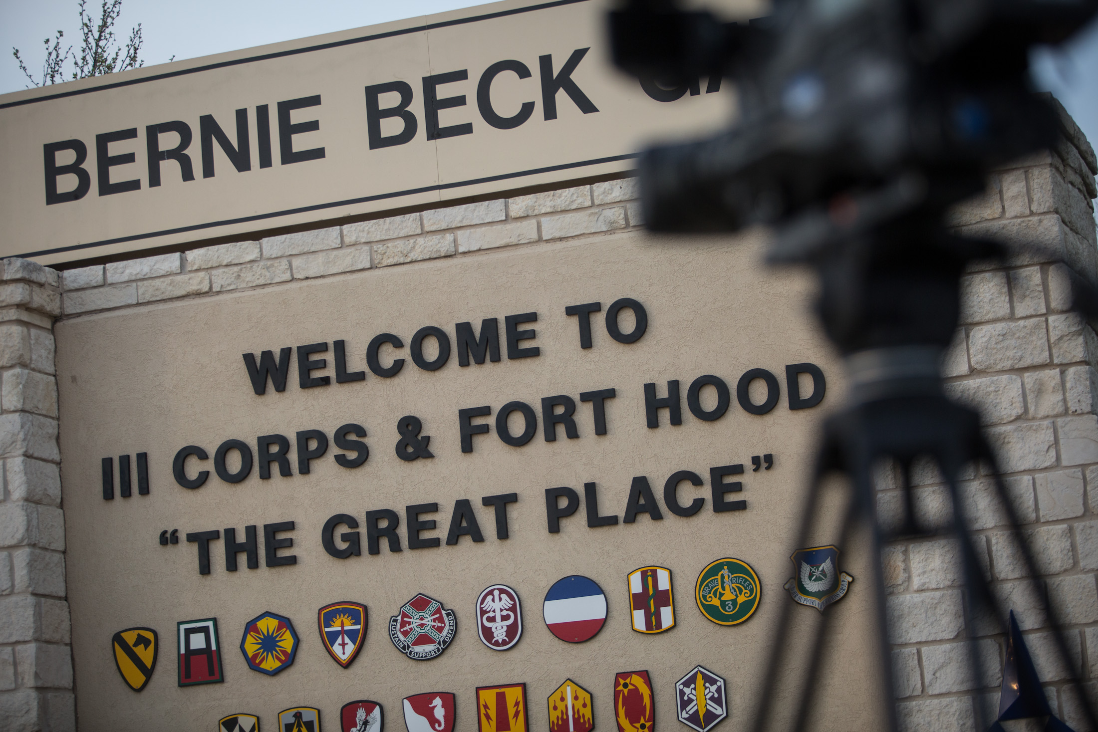 Members of the media wait outside of the Bernie Beck Gate, an entrance to the Fort Hood military base, for updates on a shooting that occurred inside on Wednesday, April 2, 2014, in Fort Hood, Texas. (AP Photo/Tamir Kalifa)