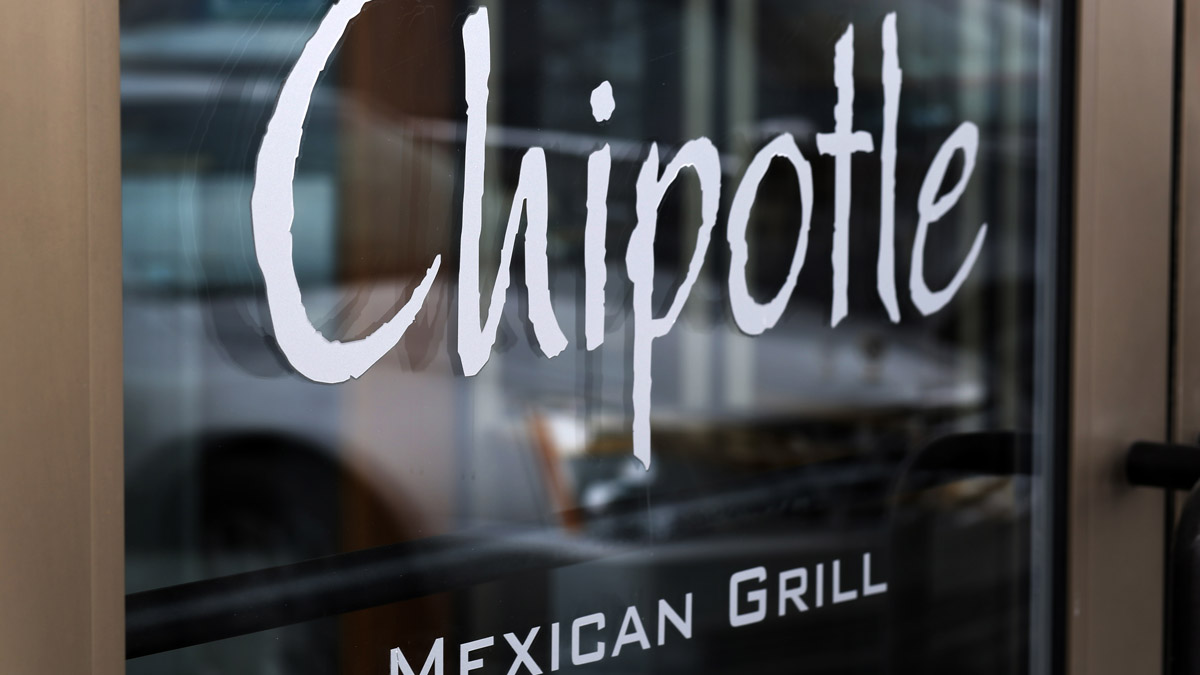 This Tuesday, Jan. 28, 2014, file photo, shows the door at a Chipotle Mexican Grill in Robinson Township, Pennsylvania.