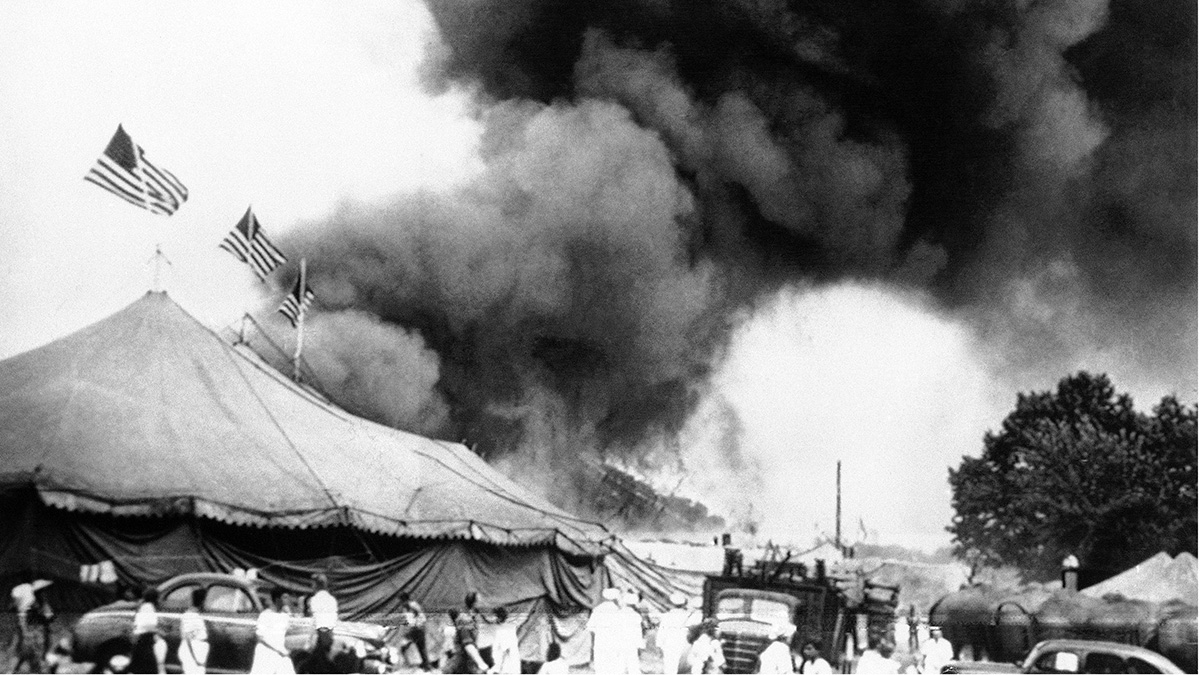 Flames shoot from the top of the main tent of the Ringling Bros. and Barnum and Bailey Circus during performance at Hartford, Connecticut on July 6, 1944. Shortly after, the tent collapsed, trapping many of the patrons who were still in the arena. (AP Photo)