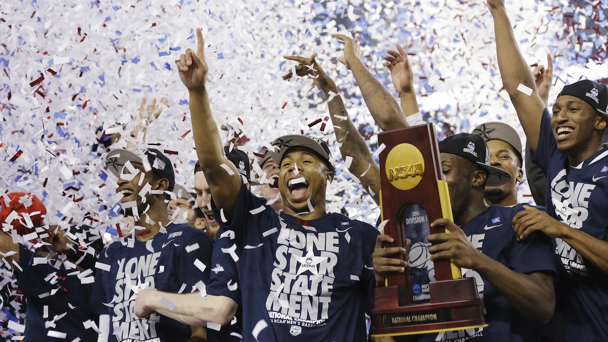 Connecticut celebrates with the championship trophy after beating Kentucky 60-54 at the NCAA Final Four tournament college basketball championship game Monday, April 7, 2014, in Arlington, Texas. (AP Photo/David J. Phillip)