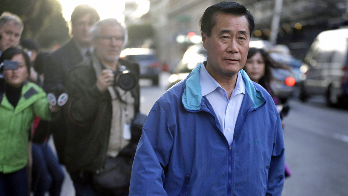 FILE - In this Wednesday, March 26, 2014 file photo, California state Sen. Leland Yee, D-San Francisco, right, leaves the San Francisco Federal Building in San Francisco. (AP Photo/Ben Margot,File)