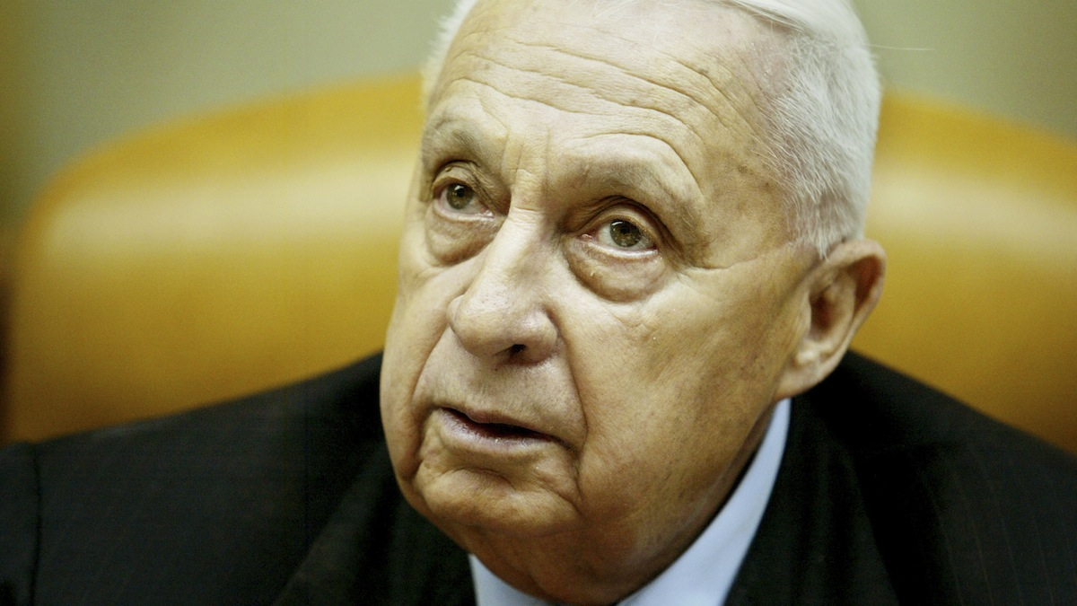 In this Sunday Jan. 30, 2005, file photo, then-Israeli Prime Minister Ariel Sharon pauses during a cabinet meeting. Sharon, 85, was in a coma since 2006 when a devastating stroke incapacitated him at the height of his political power. His condition took a turn for the worse, hospital officials said in early January. Israeli media reported his death on Jan. 11, 2014. Click through to see photos from Sharon's military and political career.