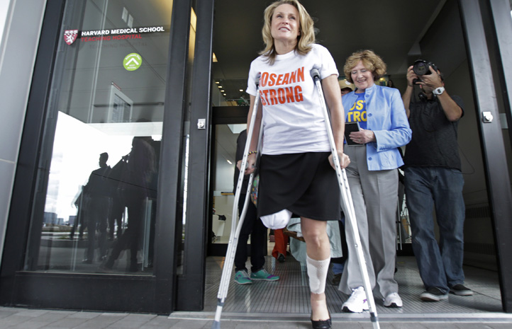 Boston Marathon bombing survivor Roseann Sdoia, of the North End neighborhood of Boston, leaves Spaulding Rehabilitation Hospital in Boston, Tuesday, May 14, 2013. Sdoia lost part of her right leg in the explosions near the finish line. (AP Photo/Charles Krupa)