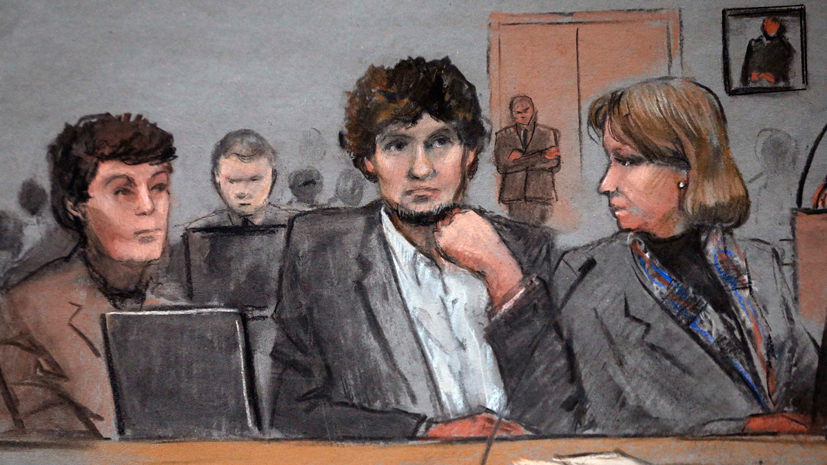 Dzhokhar Tsarnaev is depicted between defense attorneys Miriam Conrad, left, and Judy Clarke, right, during his federal death penalty trial on March 5, 2015, in Boston, Massachusetts.