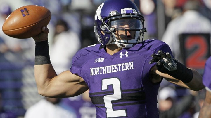Northwestern quarterback Kain Colter (2) looks to a pass during the first half of an NCAA college football game against Iowa in Evanston, Ill., Saturday, Oct. 27, 2012. (AP Photo/Nam Y. Huh)