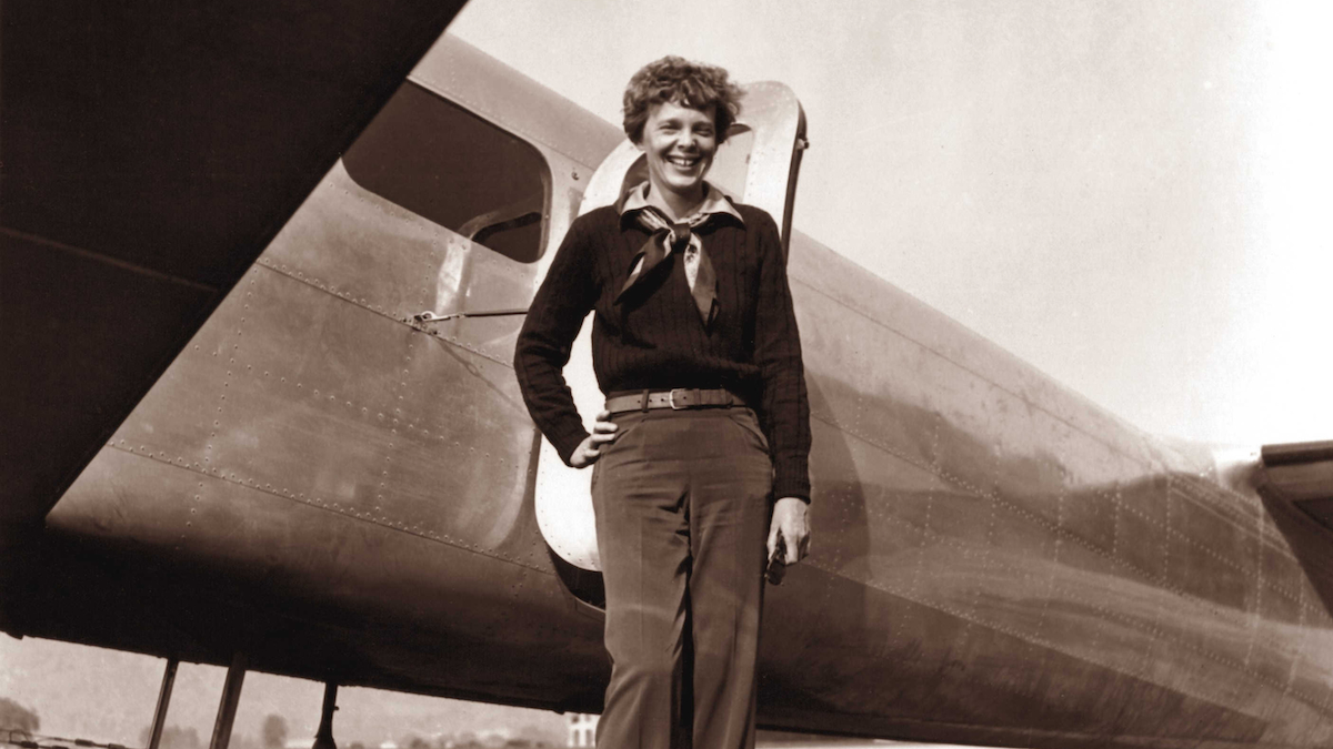 In this May 20, 1937, photo, provided by The Paragon Agency,shows aviator Amelia Earhart and her Electra plane, taken by Albert Bresnik at Burbank Airport in Burbank, Calif. New research suggests she might have died as a castaway on an uninhabited island.