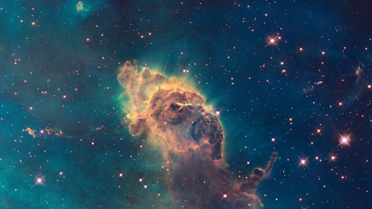Composed of gas and dust, the tip of the three-light-year-long pillar in a stellar nursery called the Carina Nebula, is located 7,500 light-years away from the Earth.